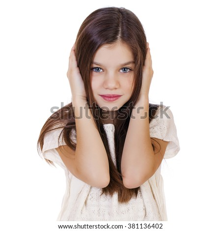 Portrait of a charming little girl covering ears with hands, isolated on white background - stock photo
