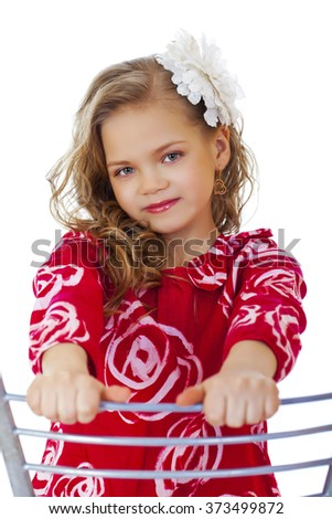 Portrait of a charming little girl looking at camera, isolated on white background - stock photo