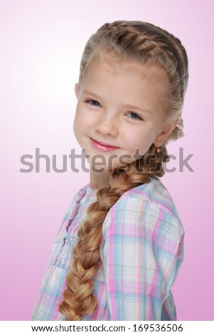 Portrait of a charming little girl with beautiful long braid on white background
