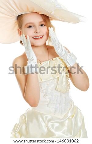 Portrait of a charming little lady in a beautiful elegant dress. Isolated over white.