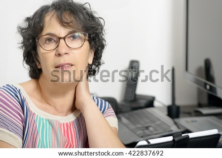 portrait of a charming middle-aged woman in his office