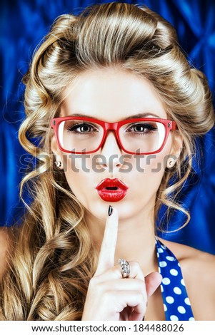 Portrait of a charming pin-up woman with retro hairstyle and make-up. - stock photo