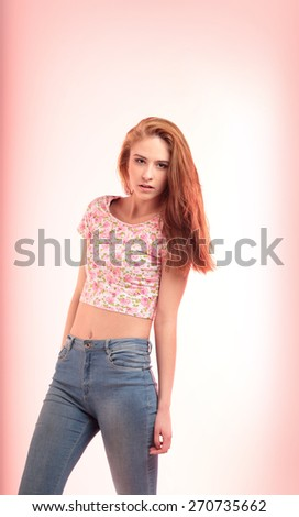 Portrait of a charming  woman posing in studio over pink background. - stock photo