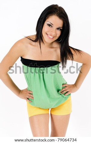 Portrait of a charming young female smiling against white background - stock photo