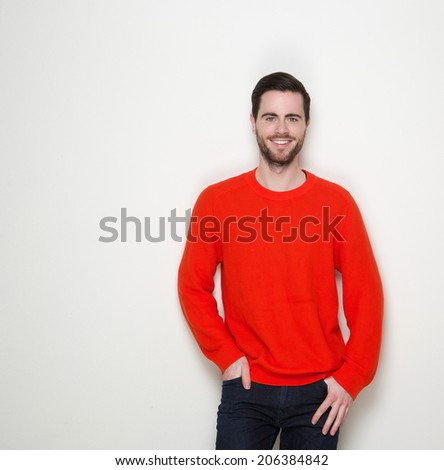 Portrait of a charming young man smiling against white background - stock photo