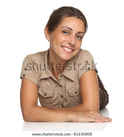Portrait of a charming young woman on white background - stock photo