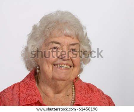 Portrait of a cheerful and happy senior woman - stock photo