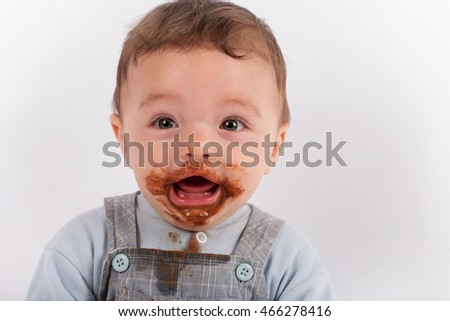 Portrait of a cheerful baby after he eat chocolate