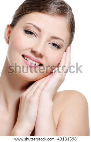 Portrait of a cheerful beauty young girl with a perfect clear skin - stock photo