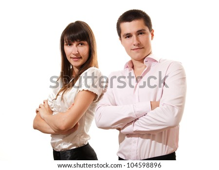 Portrait of a cheerful business couple standing together with folded arms on white background - stock photo