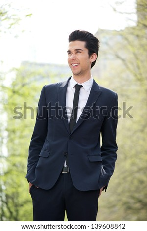 Portrait of a cheerful businessman smiling outdoors - stock photo