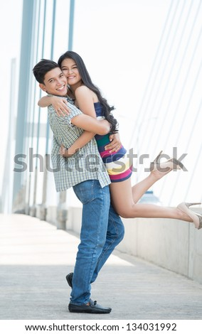Portrait of a cheerful couple having fun outside - stock photo