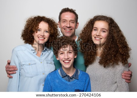 Portrait of a cheerful family with son and daughter smiling together - stock photo