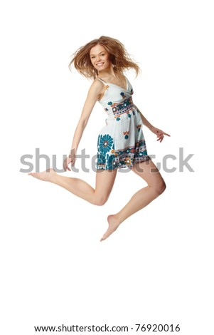 Portrait of a cheerful girl jumping - stock photo