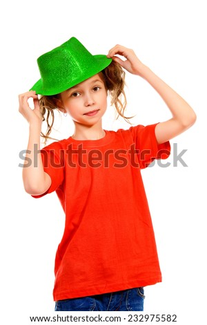 Portrait of a cheerful girl wearing party hat smiling at camera. Isolated over white. - stock photo