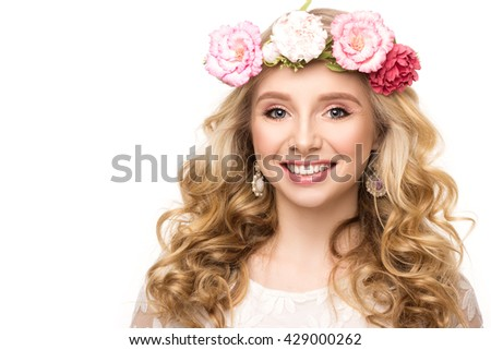 Portrait of a cheerful girl with wreath of flowers. Isolated on white background with copyspace for your text. Blond hair, blue eyes, beautiful smile. Youth, happiness concept. - stock photo