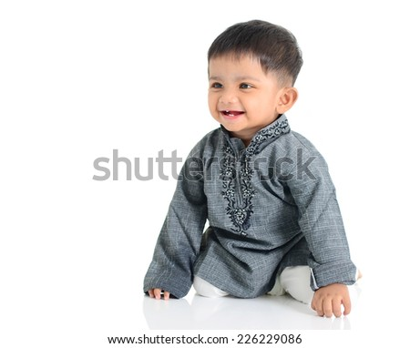 Portrait of a cheerful indian baby in traditional costume - stock photo