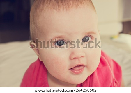 portrait of a cheerful little baby girl close-up. carefree childhood - stock photo