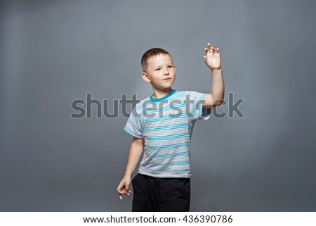 Portrait of a cheerful little boy - stock photo