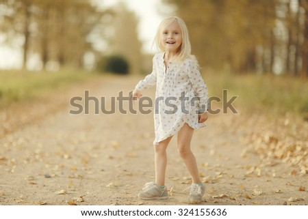 Portrait of a cheerful little girl outside - stock photo