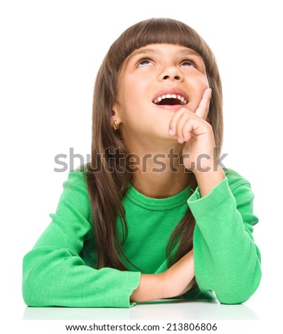 Portrait of a cheerful little girl touching his cheek with index finger, isolated over white - stock photo