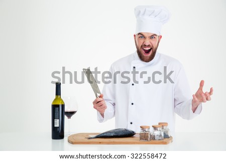 Portrait of a cheerful male chef cook preparing fish isolated on a white background - stock photo