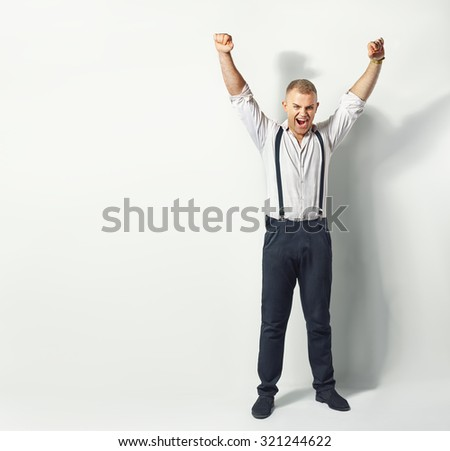 Portrait of a cheerful man with raised hands up