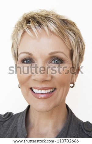 Portrait of a cheerful middle aged woman - stock photo