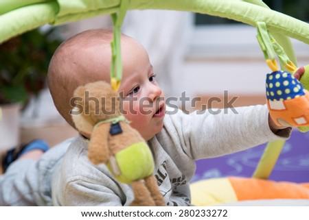 Portrait of a cheerful newborn. - stock photo
