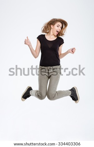 Portrait of a cheerful woman jumping isolated on a white background - stock photo