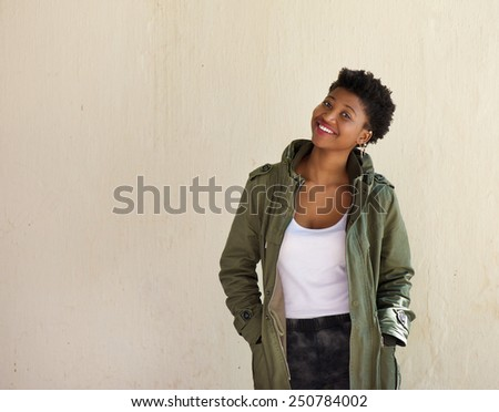 Portrait of a cheerful young african american woman smiling - stock photo