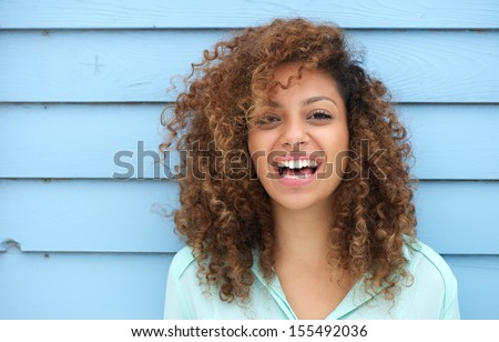 Portrait of a cheerful young african woman smiling - stock photo