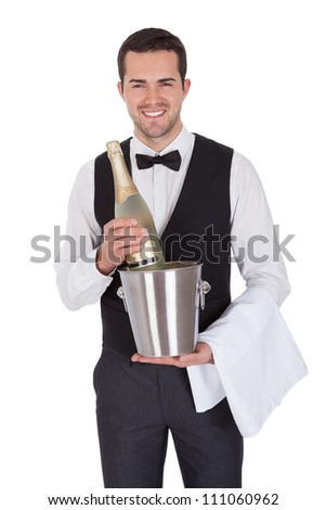 Portrait of a cheerful young butler. Isolated on white - stock photo