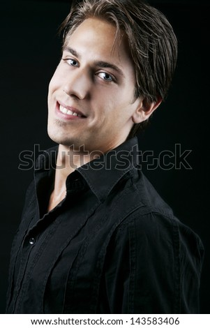 Portrait of a cheerful young man all smiles - stock photo