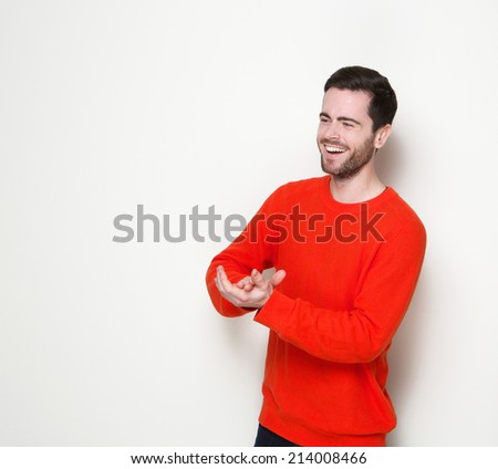 Portrait of a cheerful young man clapping hands - stock photo