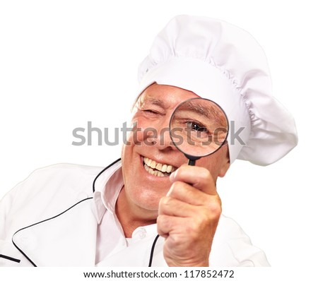 Portrait Of A Chef Holding Magnifying Glass Isolated On White Background - stock photo
