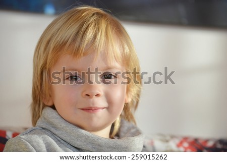 Portrait of a child aged three years old looking at camera - stock photo