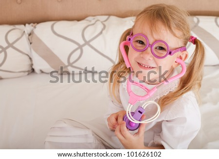 portrait of a child disguised as a doctor - stock photo