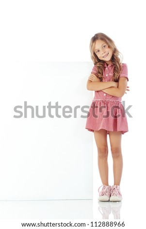 Portrait of a child girl with blank board for custom text - stock photo