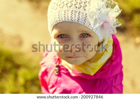 Portrait of a child looking at the camera - stock photo