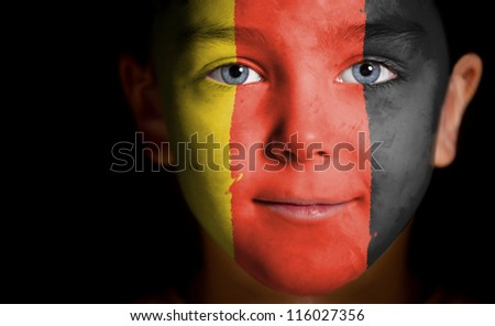 Portrait of a child with a painted German flag, closeup