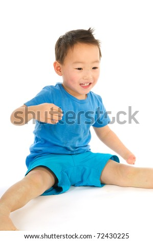 Portrait of a Chinese boy with light handicap isolated over white