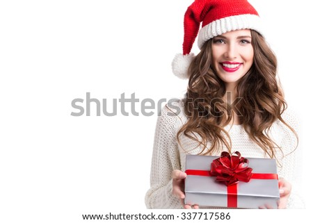 Portrait of a Christmas woman. Cute woman holding a Christmas and New Year gifts. Christmas girl in santa hat with boxes isolated. - stock photo