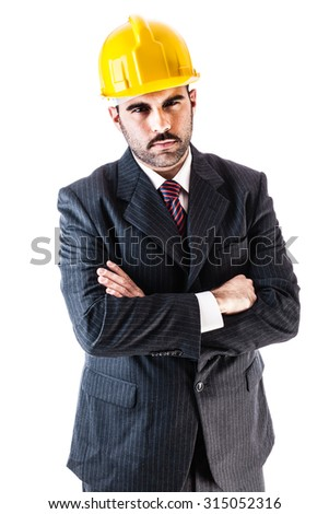 portrait of a classy businessman wearing a suit and a hard hat isolated over a white background - stock photo