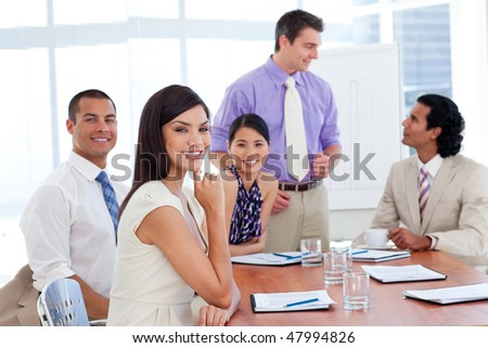 Portrait of a concentrated business team in the office during the meeting - stock photo