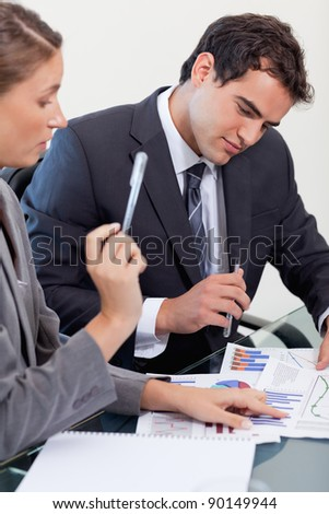 Portrait of a concentrated business team studying statistics in a meeting room