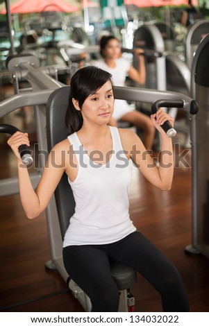 Portrait of a concentrated sportswoman in the gym - stock photo