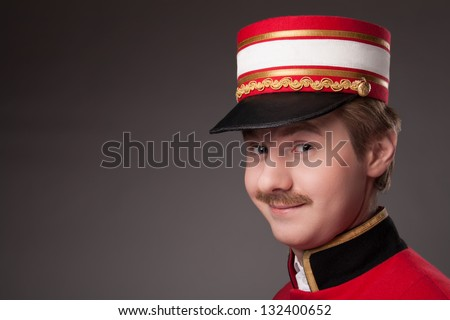 Portrait of a concierge (porter) - stock photo