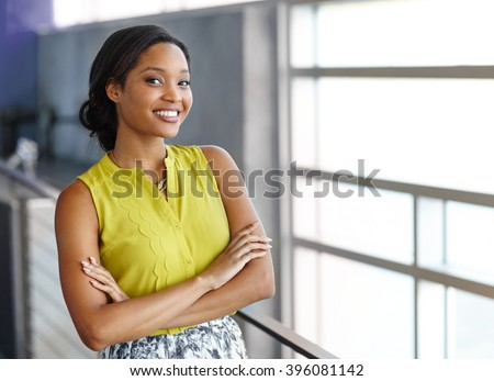Portrait of a confident black businesswoman at work in her glass office - stock photo