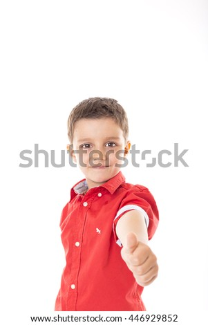Portrait of a confident  boy showing thumb up isolated on white - stock photo